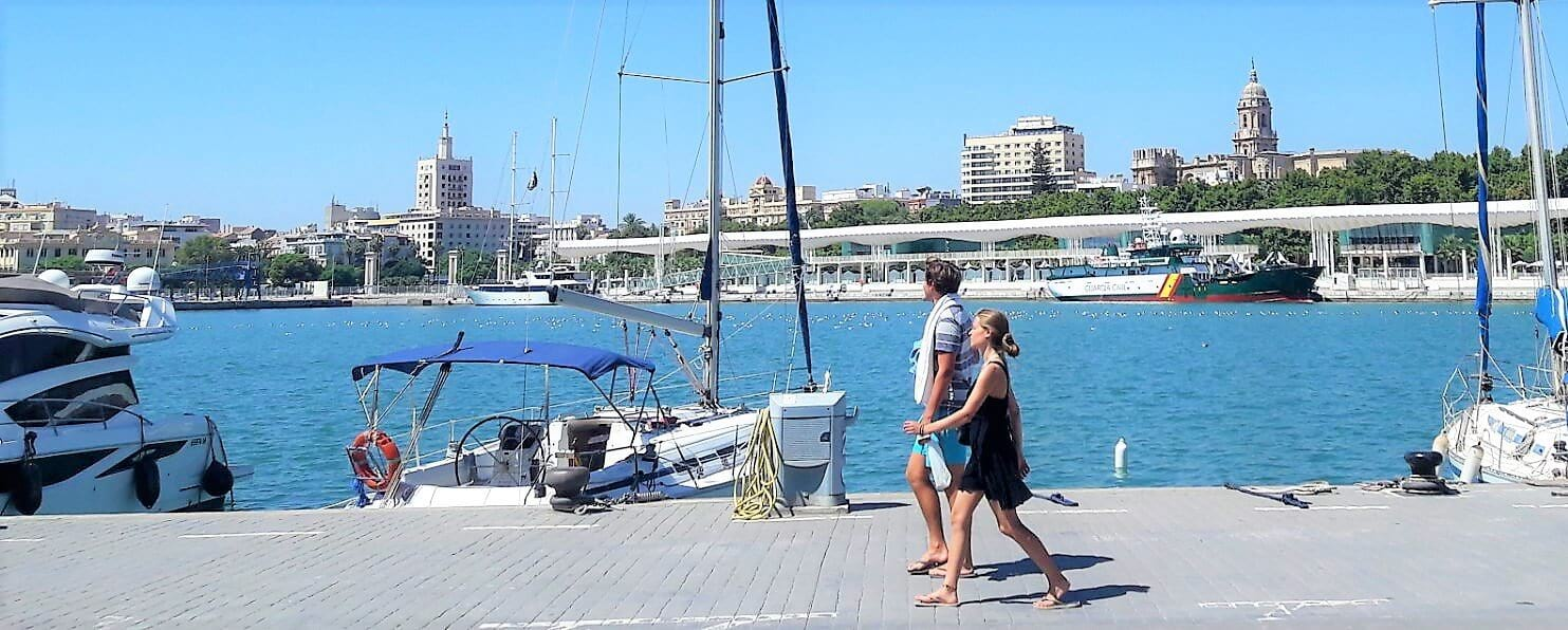 Malaga Trips couple walking muelle uno